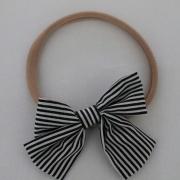 Haarbandje gestreepte strik