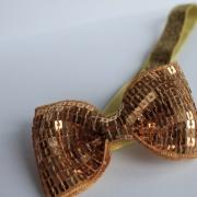 Haarbandje gouden glitter strik