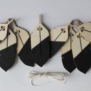 Slinger houten veren