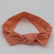Zalmroze wrap haarband