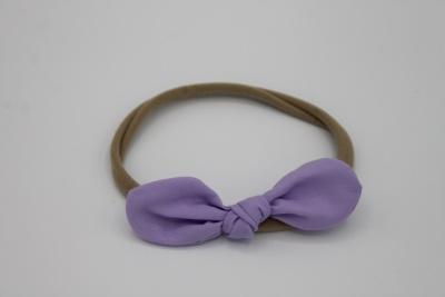 Haarbandje lila stoffen strik