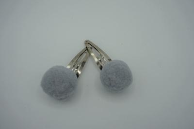 Setje haarspeldjes grijze pompoms