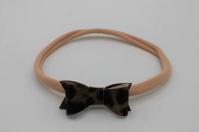 Oudroze nylon haarbandje met PU leren leopard strik