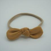 Haarband tricot strik okergeel