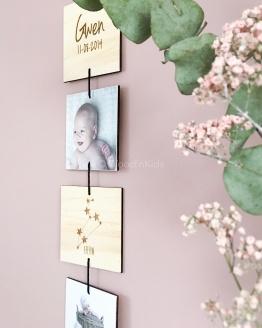 Houten geboorteslinger met foto's verticaal