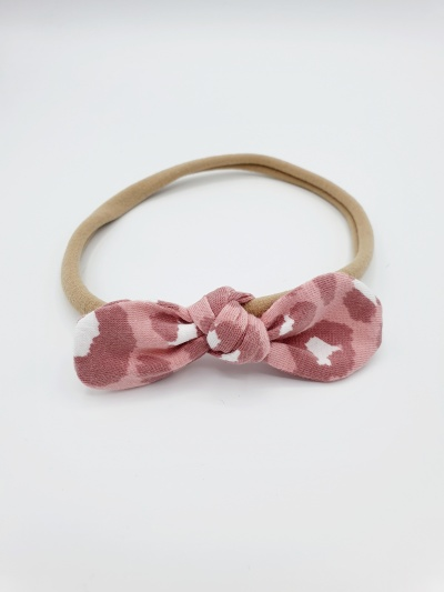 Haarband tricot roze panter strik