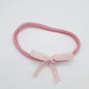 Roze haarband met roze fluwelen strik