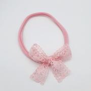 Roze haarbandje met roze kanten strik